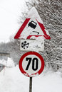 Traffic signs and snow symbol photo for winter weather accident risk speed limit Royalty Free Stock Photos