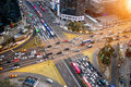 Traffic speeds through an intersection in Gangnam.Gangnam is an affluent district of Seoul. Korea. Royalty Free Stock Photo