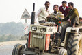 Traffic on streets of india people crowded a tractor that is tilted due to the bank the road Royalty Free Stock Photography