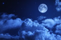 Tragic night sky with a full moon and shining stars Stock Image