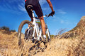 Trail bike riding mountain man with blue sky on outdoor in nature Stock Images