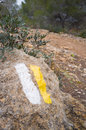 Trail marker painted rocky soil hiking trail background Royalty Free Stock Photography