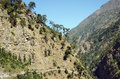 Trail on a mountain slope steep typical for the route in the himalayas Stock Image