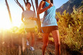 Trail running marathon athlete outdoors sunrise couple training for fitness and healthy lifestyle Royalty Free Stock Photos