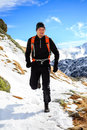 Trail running in mountains on winter beautiful day young man or fall sunny male athlete cross country runner training for ultra Royalty Free Stock Photos