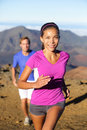 Trail running woman runner healthy lifestyle women concept with runners couple outside in beautiful landscape happy Stock Images