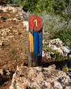 Trail sign yellow red and blue hiking with the number one on it Royalty Free Stock Image