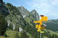 Trail signs direction nearby grosser mythen mountain in alps in switzerland Royalty Free Stock Image