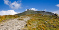 Trail to the top of pip ivan ukrainian carpathian mountains in summer with blue sky and clouds one highest tops in ukraine white Royalty Free Stock Photo