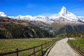 Trail with view of Matterhorn Peak in summer at Sunnega station, Rothorn Paradise, Zermatt, Switzerland Royalty Free Stock Photo