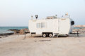 Trailer on the beach in Qatar Stock Images