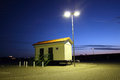 Trailer public restroom on a at night Royalty Free Stock Photos