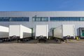 Trailers at docking stations of a distribution centre white waiting to be loaded station Royalty Free Stock Photo