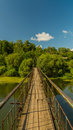 The trailing old bridge through the Ural river Stock Photography
