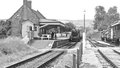 Train approaching washford station on west somerset railway Royalty Free Stock Images