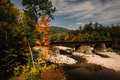 Train bridge over a river and autumn color near bethel maine Royalty Free Stock Photography