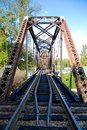Train bridge perspective through a steel Royalty Free Stock Photo