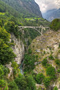 Train bridge switzerland arch crossing deep cut river valley at stalden saas valais Stock Images