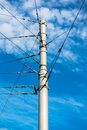 Train catenary and power line cables against the blue sky Royalty Free Stock Image