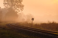Train is coming local to a small village station during a foggy morning Stock Image