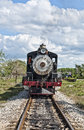 A train is coming steam locomotive in the country side of cuba photo taken jan Royalty Free Stock Image