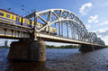 Train crosses the iron bridge over the daugava river in riga a traveling across latvia Royalty Free Stock Photos