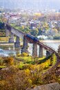 Railway bridge over the river. A train crosses a river. Nice view of the countryside. View from above. Royalty Free Stock Photo