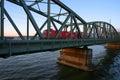 Train crossing bridge over river Stock Photos