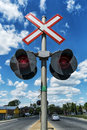 Train crossing late afternoon sun blue sky with wispy clouds Royalty Free Stock Image