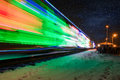 Train decorated with holiday lights arrives at station green Stock Image