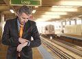 Train delay businessman looking at his watch Royalty Free Stock Photography