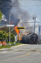 Train derailment lac megantic flames quebec derailed oil tanker car on fire in billowing smoke and rise from the remains Stock Image