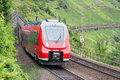 Train driving along german river Moselle