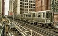 Train on elevated tracks within buildings at the Loop, Chicago City Center - Black Gold Artistic Effect - Chicago, Illinois