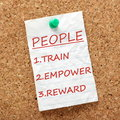 Train empower and reward the way to success with your people or staff is to as per this reminder attached to a cork notice board Royalty Free Stock Photography