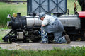 Train engineer stops to oil part small steam train operates hesston steam museum hesston indiana Stock Images