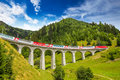 Train on famous landwasser Viaduct bridge, Switzerland Royalty Free Stock Photo
