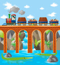 Train loaded with rocks and woods over the bridge