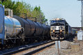 Train locomotive passing additional freight train Royalty Free Stock Photo