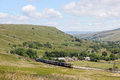 Train in Mallerstang valley on Settle to Carlisle Royalty Free Stock Photo