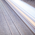 Train with motion on rails blur Royalty Free Stock Photos