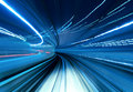 Train moving fast in tunnel Royalty Free Stock Photo