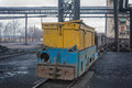 Train in national colors with trolleys in a coal mine Royalty Free Stock Photo
