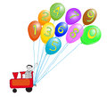 Train with numbers and colorful baloons toy operated by smiling boy for preschool learning Stock Image