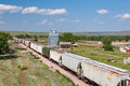 Train Passing Old Grain Elevator in South Dakota Royalty Free Stock Photo