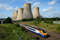 Train passing power station Royalty Free Stock Photo