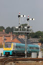 Train passing signal gantry at Shrewsbury station Royalty Free Stock Photo