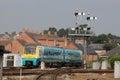 Train passing signal gantry at Shrewsbury station Royalty Free Stock Photo