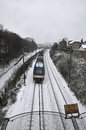 Train passing snow day grey sky Royalty Free Stock Images