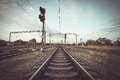 Train platform and traffic light at sunset railroad railway st station Stock Photography